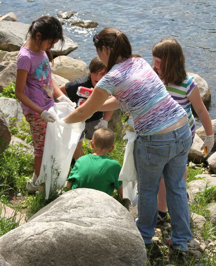 Students worked in teams on the clean-up project. Second grand students tackled the north side of the Manistee River by Tippy Dam while the fourth grade students handled the south side.(Ken Grabowski/News Advocate)