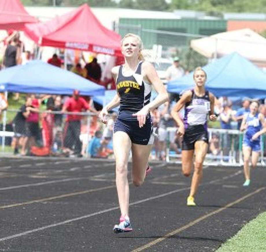 Manistee sophomore Annie Fuller runs to a first-place finish in the 800-meter run in the Division 3 state finals on Saturday at Comstock Park. Fuller broke her own state record in the 800 to repeat as champion. (Matt Wenzel/News Advocate)