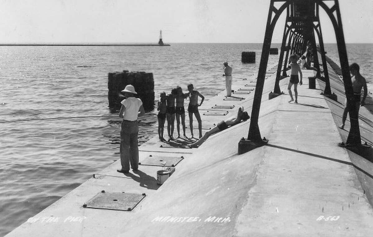 Fishing and swimming was a fun way to pass the time in the 1950s at Fifth Avenue Beach.