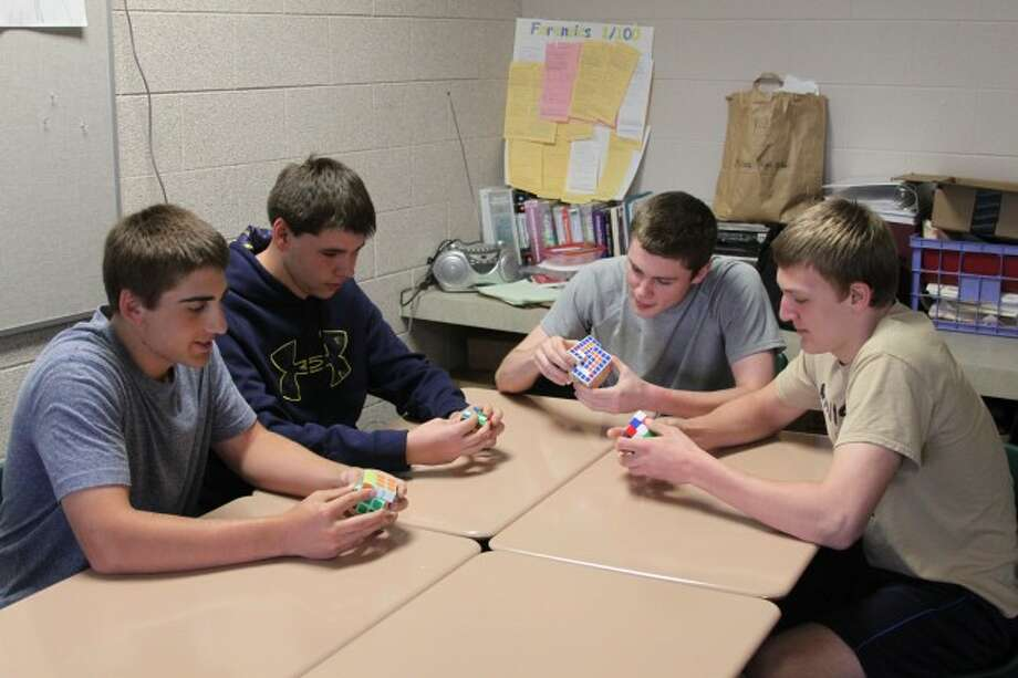 Students in Eric Thuemmel's class at Manistee High School brought back the 1980s craze over Rubik's Cubes.