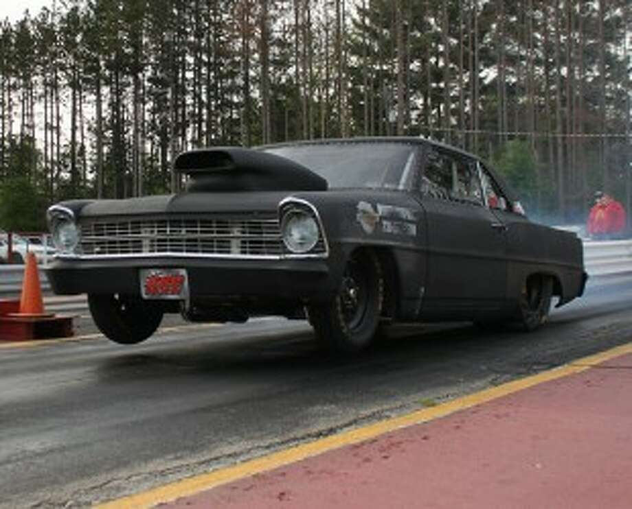 Onekama's Eric Johnson launches from the starting line in his 1966 Chevy II Nova at the Northern Michigan Dragway. (Photo courtesy of Tina Mikus)