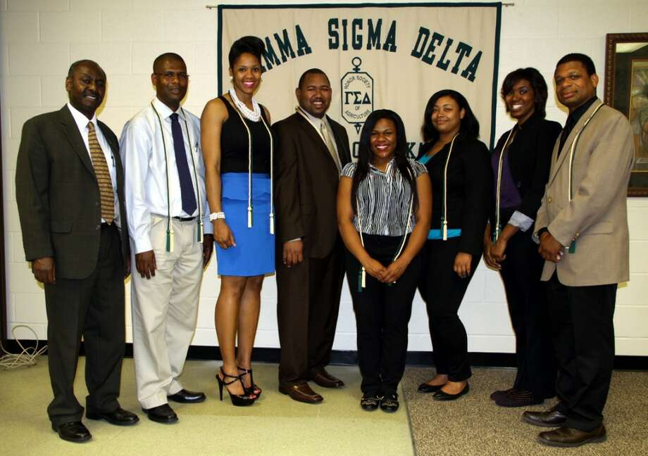 Recent inductees into the University of Arkansas at Pine Bluff chapter of Gamma Sigma Delta, the honor society of agriculture, left to right, are Dr. Obadiah Njue, Shaun Francis, Talesha Dokes, Kenyon Branch, Jessica McAfee, Cristal Amaro, Lauren Goodwin and Tracy Smith. Not pictured are Alichia Sunflower Wilson and Thomas Witherspoon.(Courtesy photo)