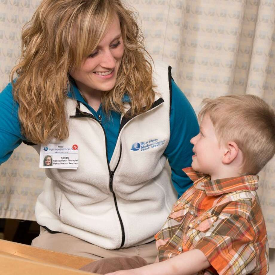 West Shore Medical Center's occupational and speech therapists will host a free seminar about ADHD on Thursday, June 12. Occupational therapist Kendra Anderson works with a youngster.