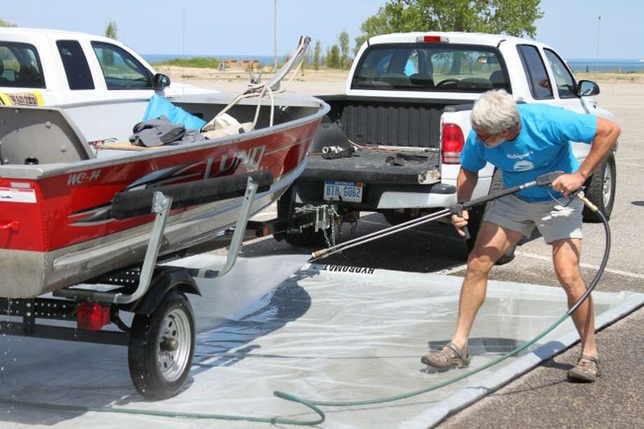 The Michigan Aquatic Invasive Species Landing Blitz came to Manistee's First Street Beach Launch area Friday and again from 10 a.m. to 2 p.m. today. Boaters had the opportunity to get their boats power washed and to be checked for aquatic invasive species.