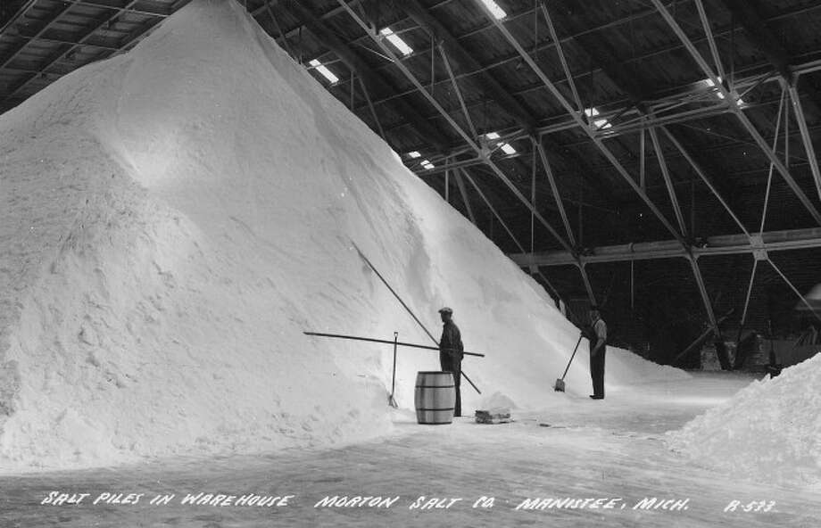 A large salt mound is shown at a Morton Salt warehouse in this 1930s picture