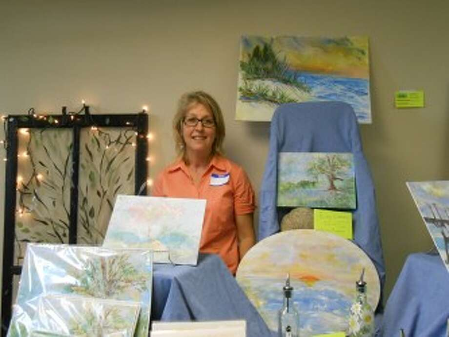 (Abigale Racine/News Advocate)Marie Bennett displayed her art, despite the trials and tribulations she has endured, last weekend in Ludington at the Maritime Art Show.