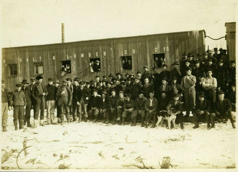 Lumberjacks from a Manistee County lumber camp line up for a group photo in this 1890s photograph.