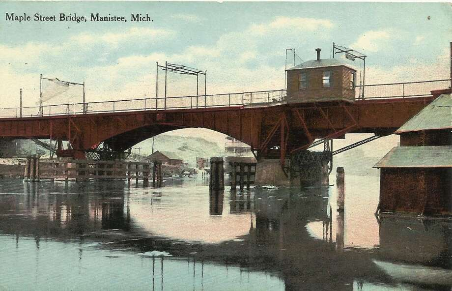 A post card view of an earlier version of the Maple Street Bridge in Manistee. (Courtesy Photo/Dale Picardat)