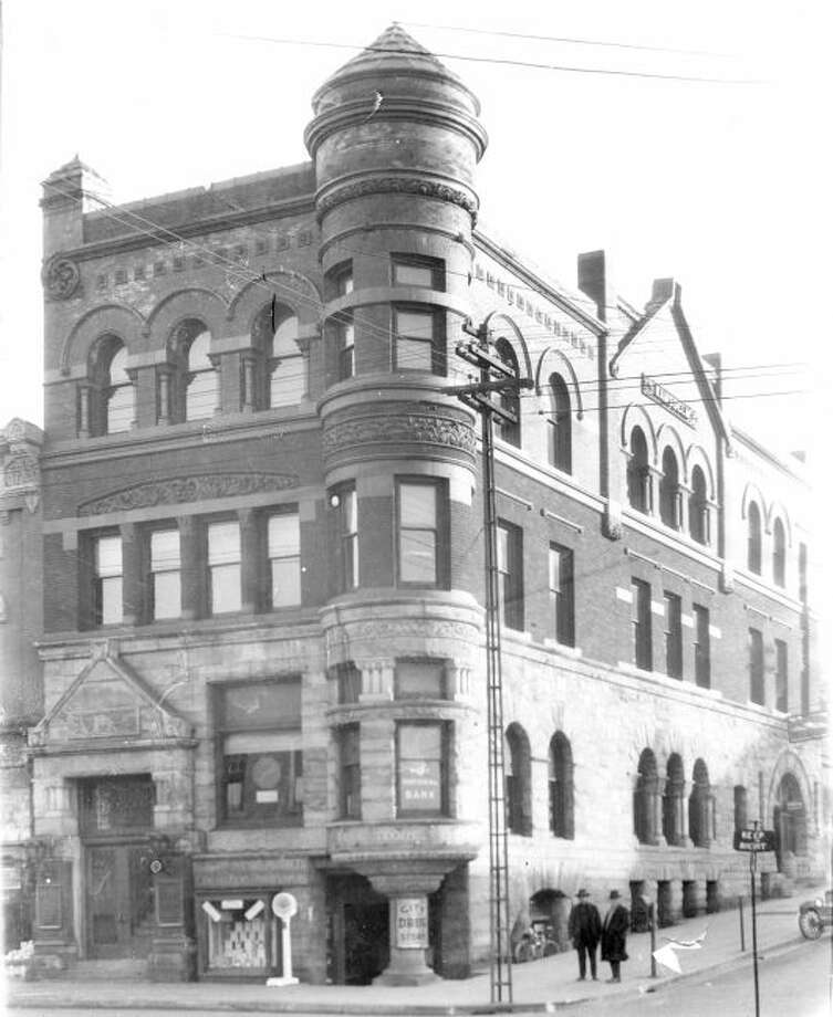 This early 1920 photo of the Ramsdell Building shows it when City Drug Store was located in the lower level and the First National Bank was on the first floor.