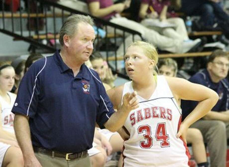 Longtime Manistee Catholic Central coach Todd Erickson, seen here giving instructions to guard Alysha Heck last season, is the new coach at Manistee. (Matt Wenzel/News Advocate file photo)
