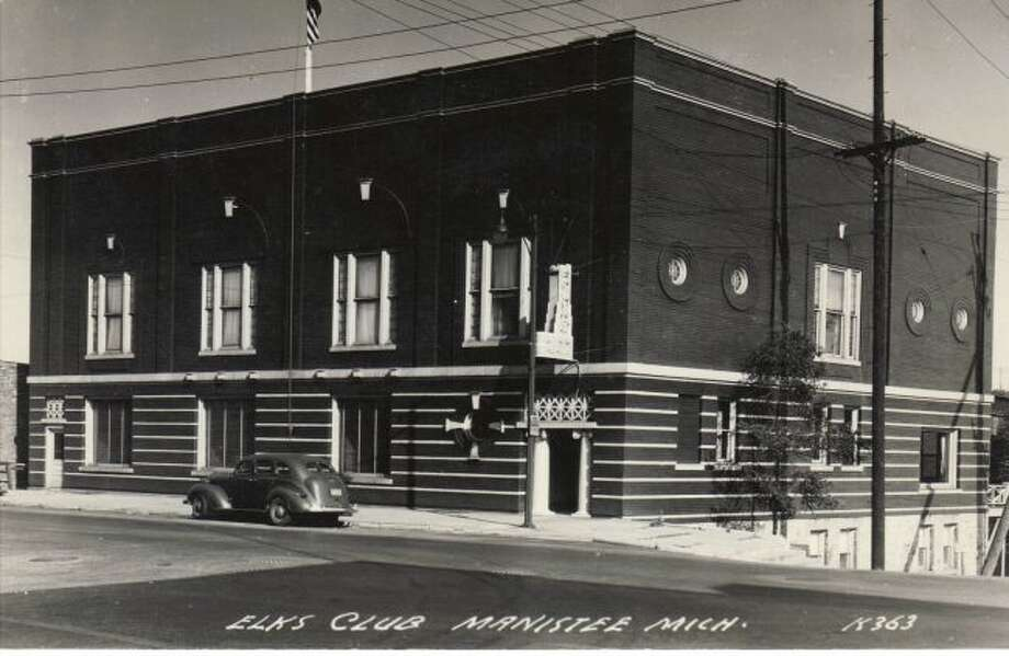 The Manistee Elks Lodge structure looked the same in this 1940s photograph, but the color of the paint was much different for what exists today.