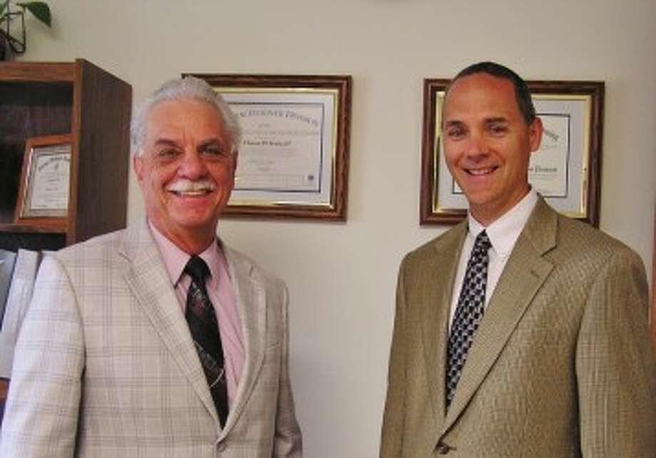 Tom Krahe (left) welcomes John Lugauer as his new associate at Krahe & Associates on Washington Street in Manistee. (Courtesy Photo)