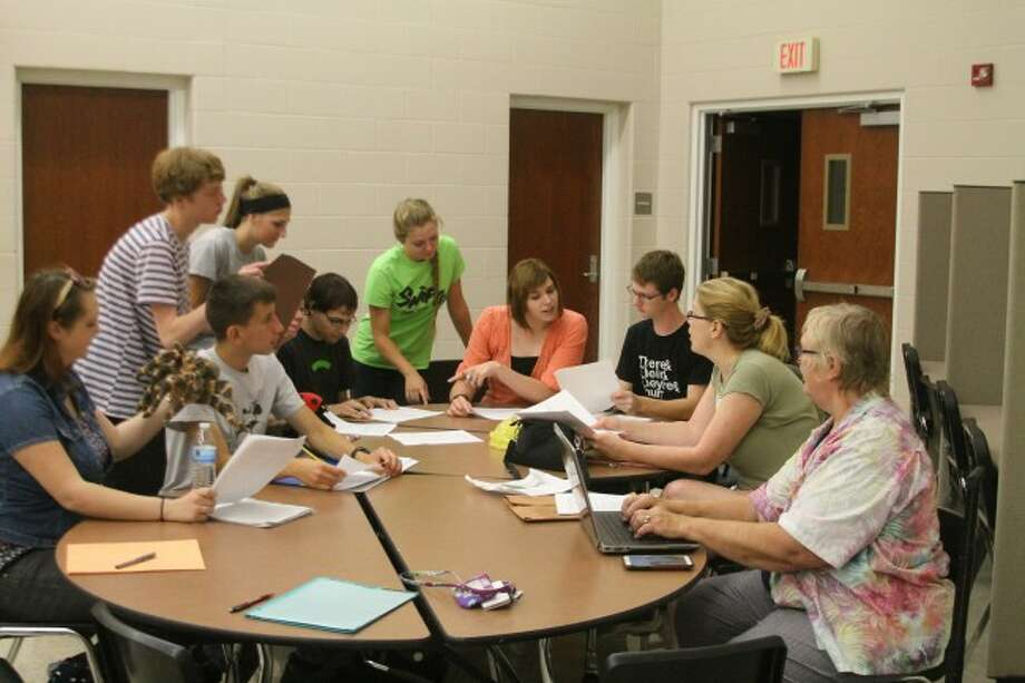 Student interns discuss what they will be doing with students from the Second Annual Children's Theatrical Workshop. The workshop will run from Aug. 17-21 at the Manistee Middle/High School auditorium.