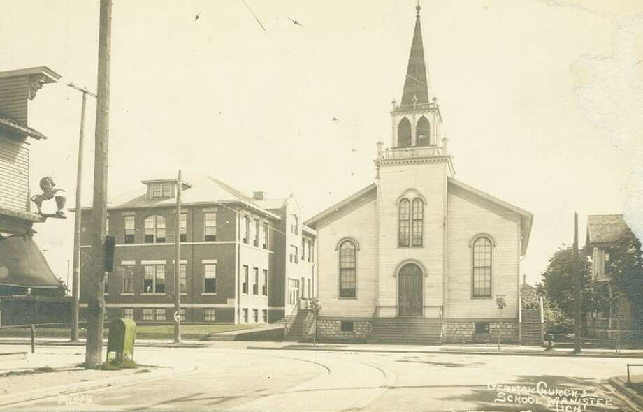 """The Trinity Lutheran Church and school are shown in this 1920s photograph. The church had many Germna immigrants that belonged to it and was known as the """"German Church"""" in Manistee."""