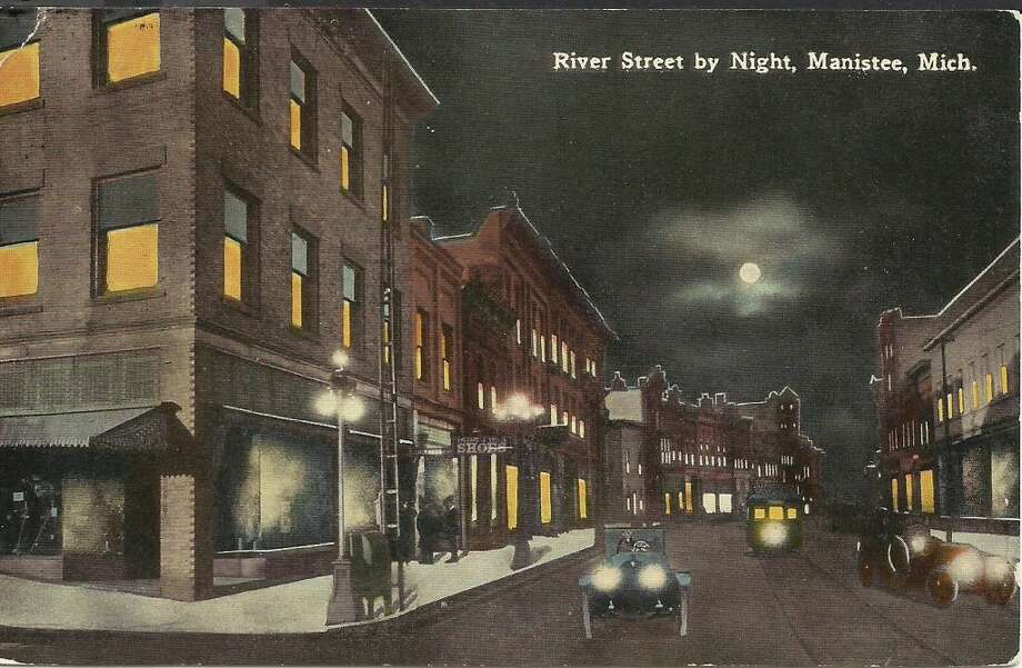 A post card from the 1910s showing a nighttime view of River Street in Manistee. (Courtesy Photo/Dale Picardat)