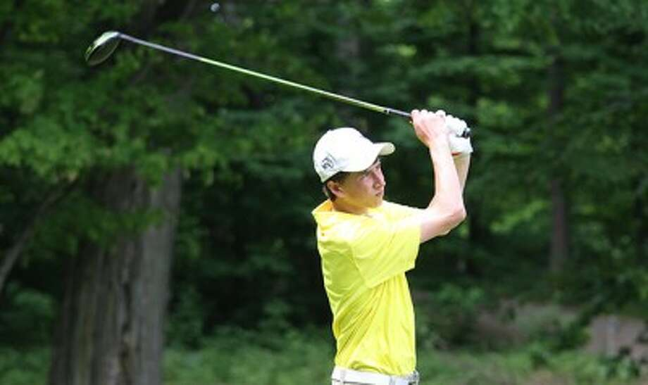 Manistee sophomore Blake Davis watches his tee shot during last Thursday's Division 3 regional tournament at Lakeside Links. (Matt Wenzel/News Advocate file photos)