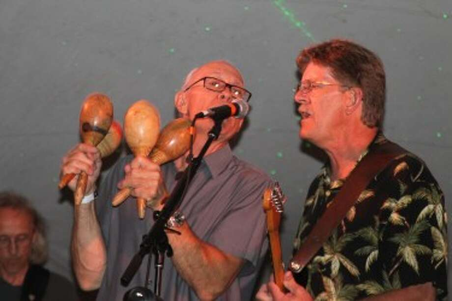 (Abigale Racine/News Advocate) Red Apple Road, a local Manistee band, helped raise funds toward the North Pier Lighthouse restoration at Saturday's Salt City Rock and Blues Reunion Show.