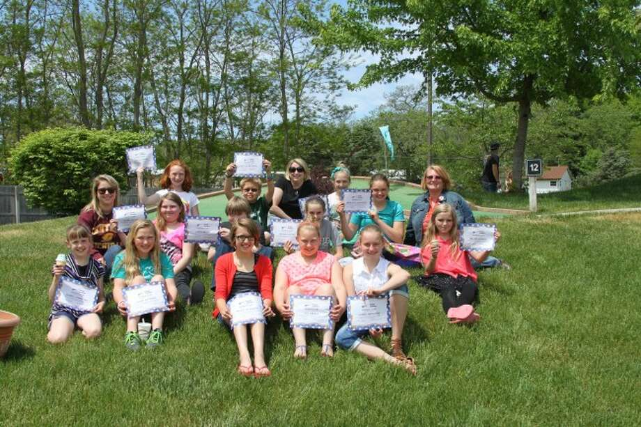 Kennedy Elementary School students from the science club pose with their certificates naming them the Project N.E.E.D. School of the Year.