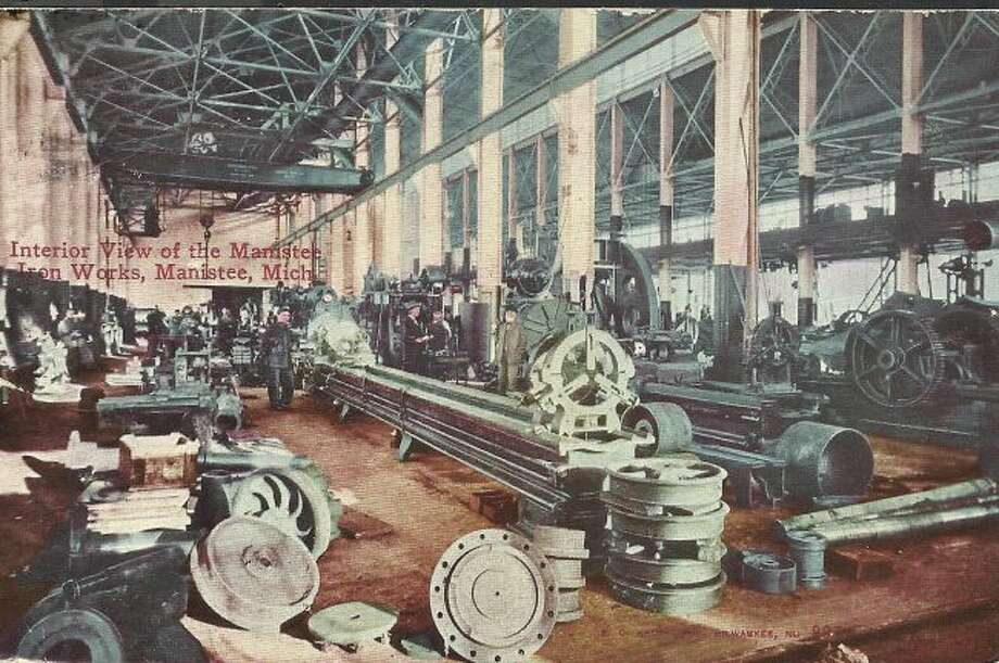 The interior of the Manistee Iron Works building is shown in this photograph from the early 1900s.