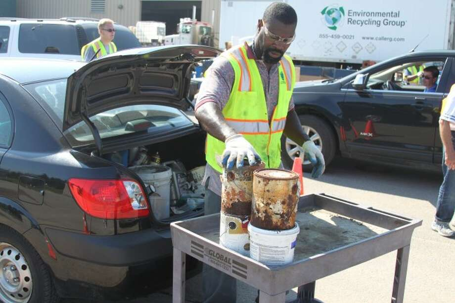 Saturday's Manistee Conservation District's Household Hazardous Waste Collection at the Manistee County Road Commission Garage drew a large response from the community. Workers from Environmental Recycling Group of Livonia handled the disposal this year.