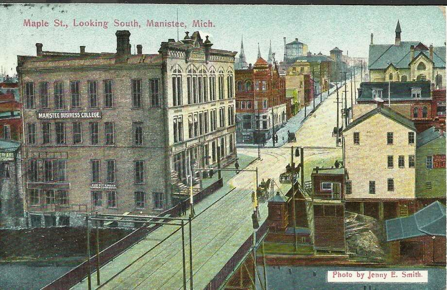 An early 1900s post card view looking south on Maple Street across the Maple Street Bridge in Manistee. (Courtesy Photo/Dale Picardat)