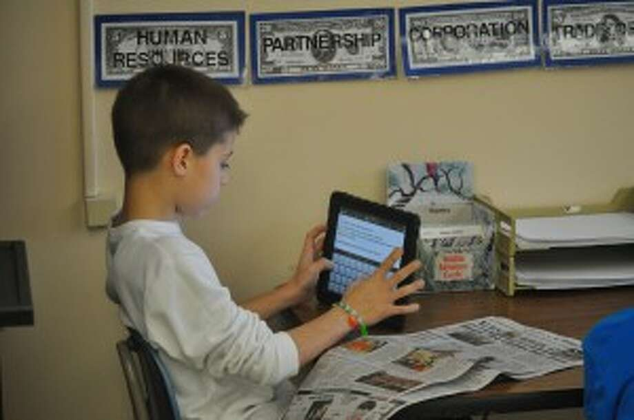 Kennedy Elementary student Jalen Tabaczka used an iPad to complete a Newspapers in Education lesson on Thursday.