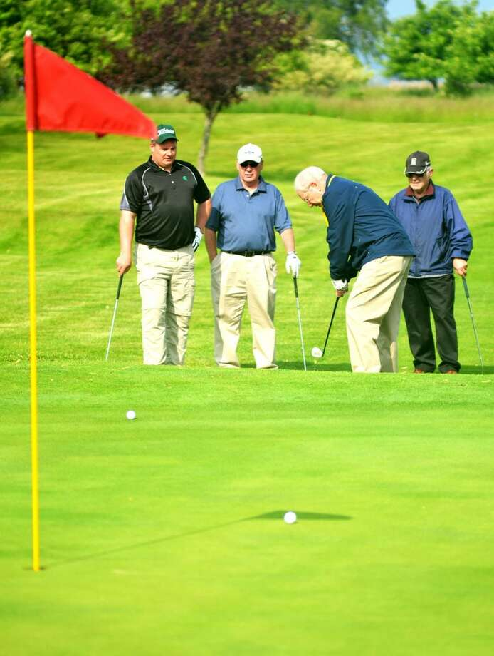 Golfers take part Saturday in the Manistee Homeward Bound fundraiser the Furball Open.