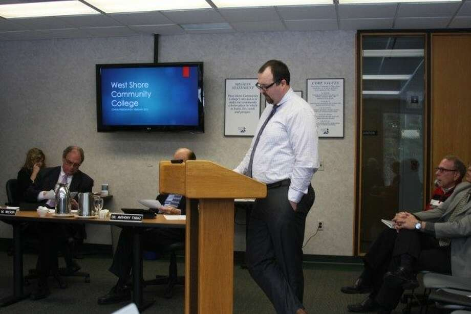 Chad Inabinet speaks to the WSCC board of trustees about the summer enrollment numbers.