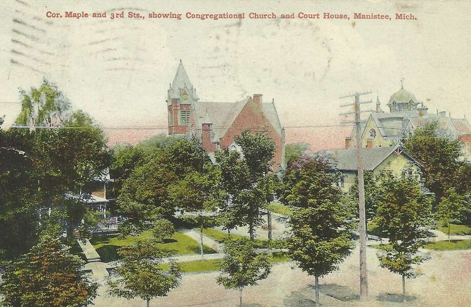 A view looking northeast at the First Congregational Church and the courthouse in Manistee in the early 1900s. (Courtesy Photo/Dale Picardat)