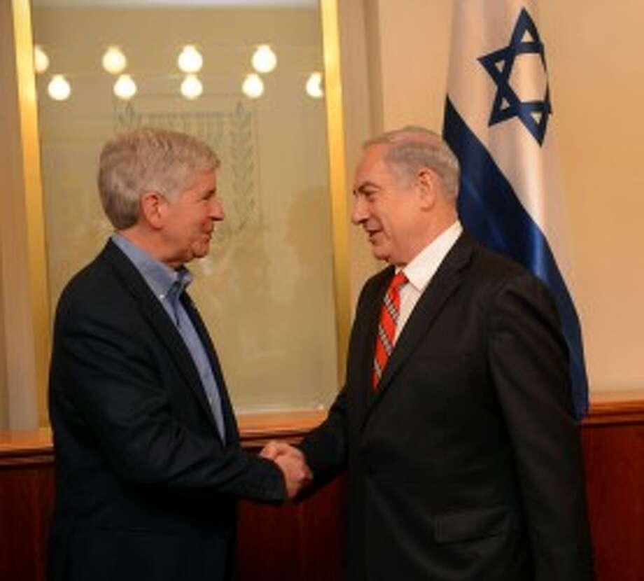 Governor of Michigan Rick Snyder greets Israeli Prime Minister Benjamin Netanyahu in his office in Jerusalem, Israel, June 17, 2013.