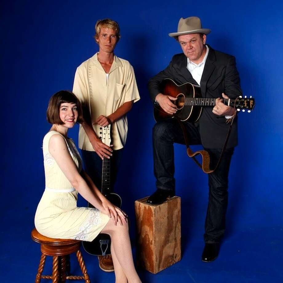 Tonight's fundraiser concert by John Reilly & Friends at the Ramsdell Theatre is sold out, however those who want to meet the actor, singer, producer and screenwriter can attend the reception to be held from 6 to 7 p.m. in the T. Walter Hardy Exhibit Hall at the Ramsdell. Pictured is the band (from left to right) Becky Stark, Tom Brosseau and John Reilly. (Courtesy Photo/Jo McCaughey)