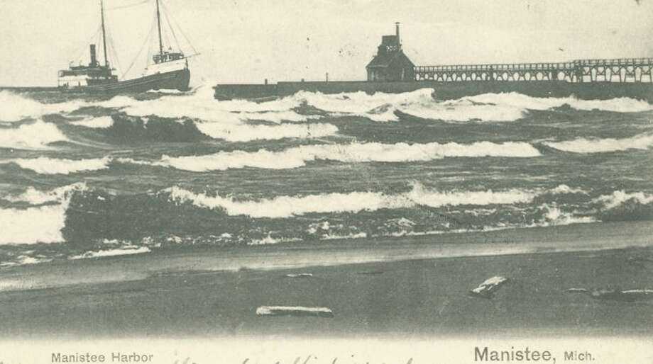 Manistee Harbor is shown on a windy day in this early 1900 photograph.