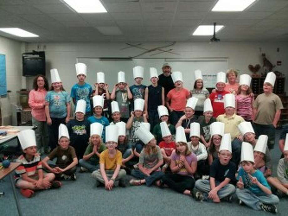 Fifth grade students at Brethren Elementary School are shown wearing hats they were awarded at the end of a six-week program called Cooking Matters. It was part of the FIT Kids program run by West Shore Medical Center and the MSU Extension office.(Courtesy photo)