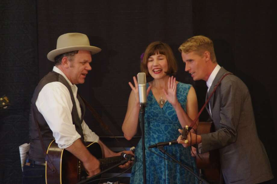 The principal members of the band John Reilly and Friends are (from left to right) John C. Reilly, Becky Stark and Tom Brosseau. They played a benefit concert for the Vogue Theatre Restoration Project on Tuesday, June 18 at the Ramsdell Theatre. (Dave Yarnell/News Advocate)