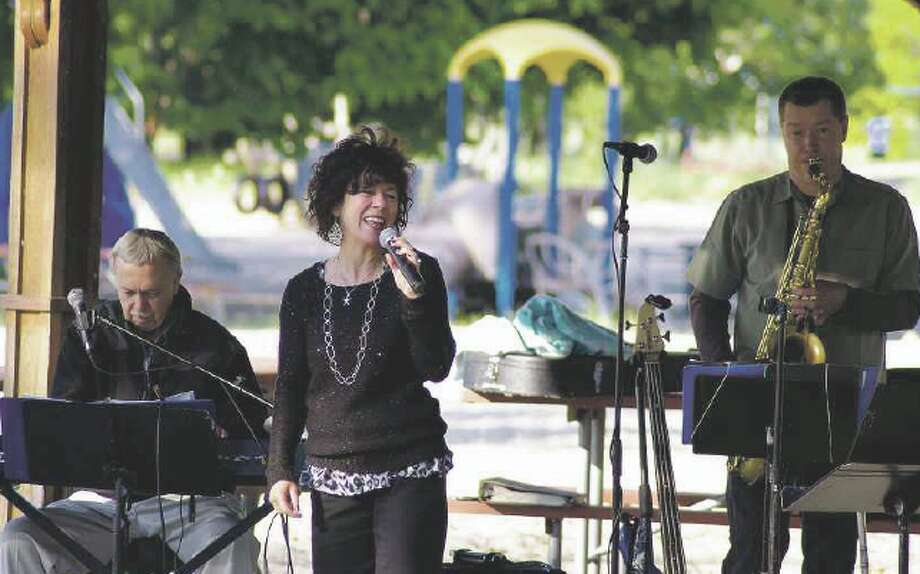 Mary Rademacher joined the Tom Hagen/Cherie Lynn Quartet for the first concert in the summer Manistee ShoreLine ShowCase jazz series at Douglas Park First Street Beach on Tuesday. (News Advocate photo/David Yarnell)