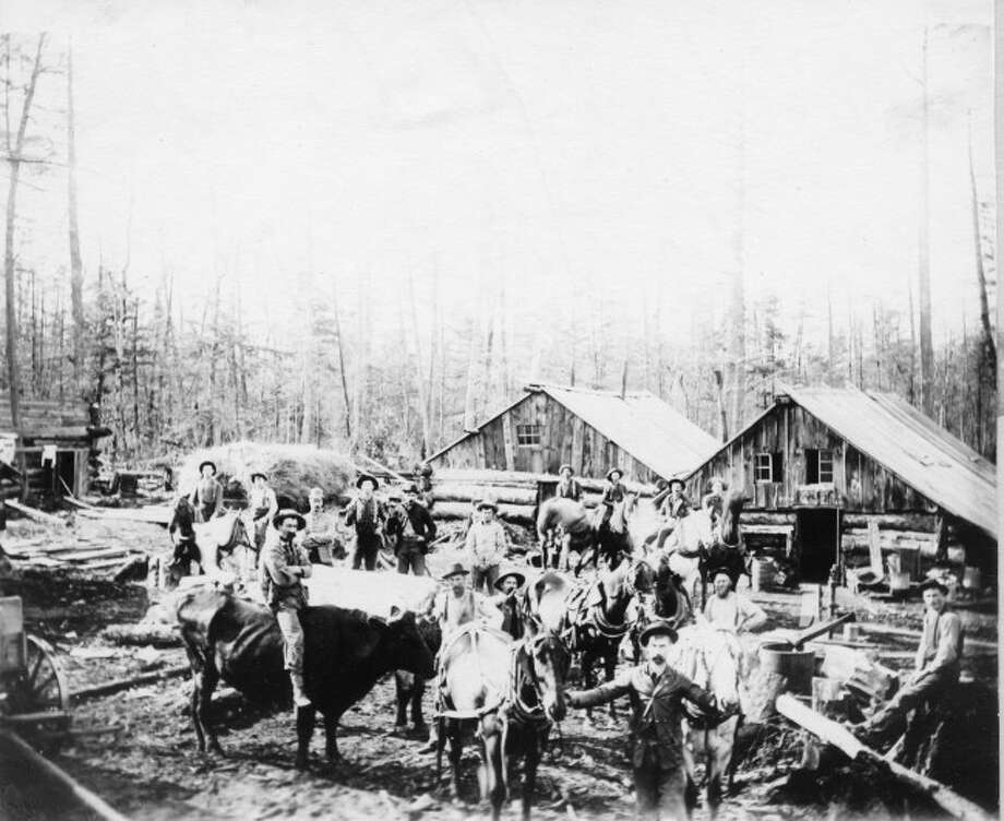 A logging crew prepares for another day of work in the forest in the late 1800s.