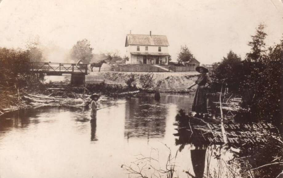 This mother and son get in son are shown doing some fishing on a hot summer day at a Manistee County Farm in this 1890's picture.