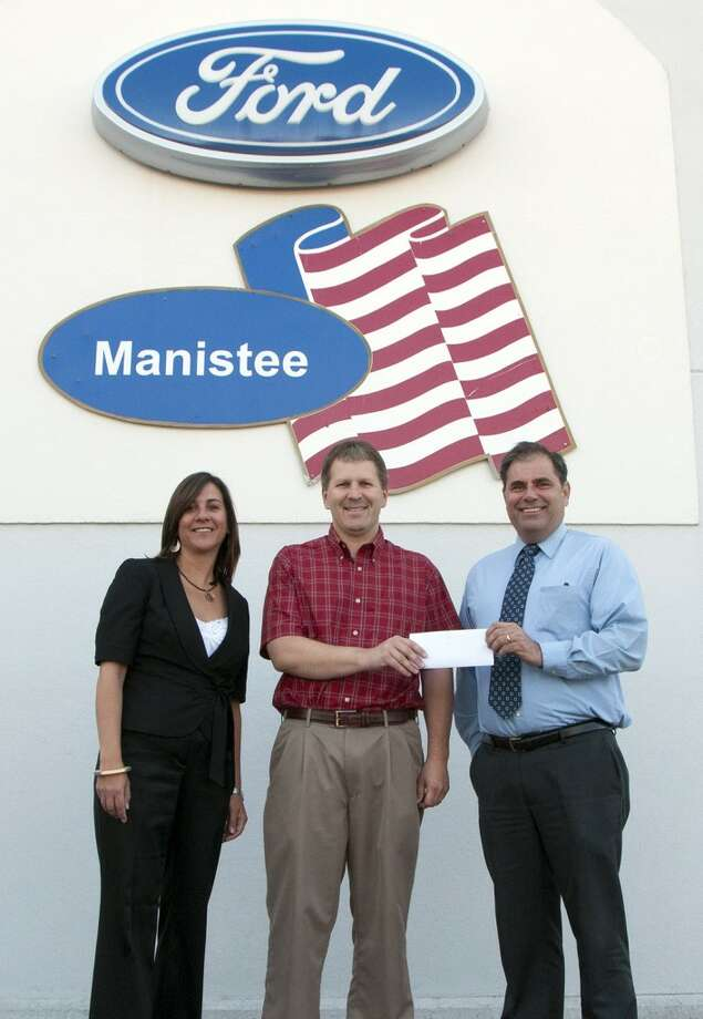Manistee Ford presents West Shore Healthcare Foundation with $2,000 to support West Shore Medical Center's commitment to the early detection of breast cancer. Pictured (l-r) are West Shore Healthcare Foundation Executive Director Rachel Estabrook, Manistee Ford's Rob Pepera, and West Shore Medical Center President James Barker.