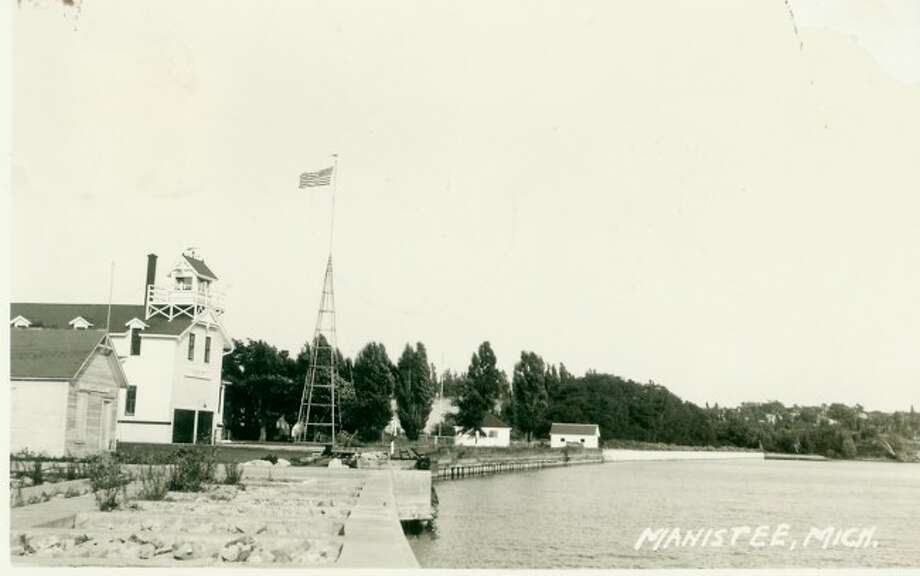 This 1950s photograph shows what Coast Guard Station Manistee looked like a boaters entered the harbor.