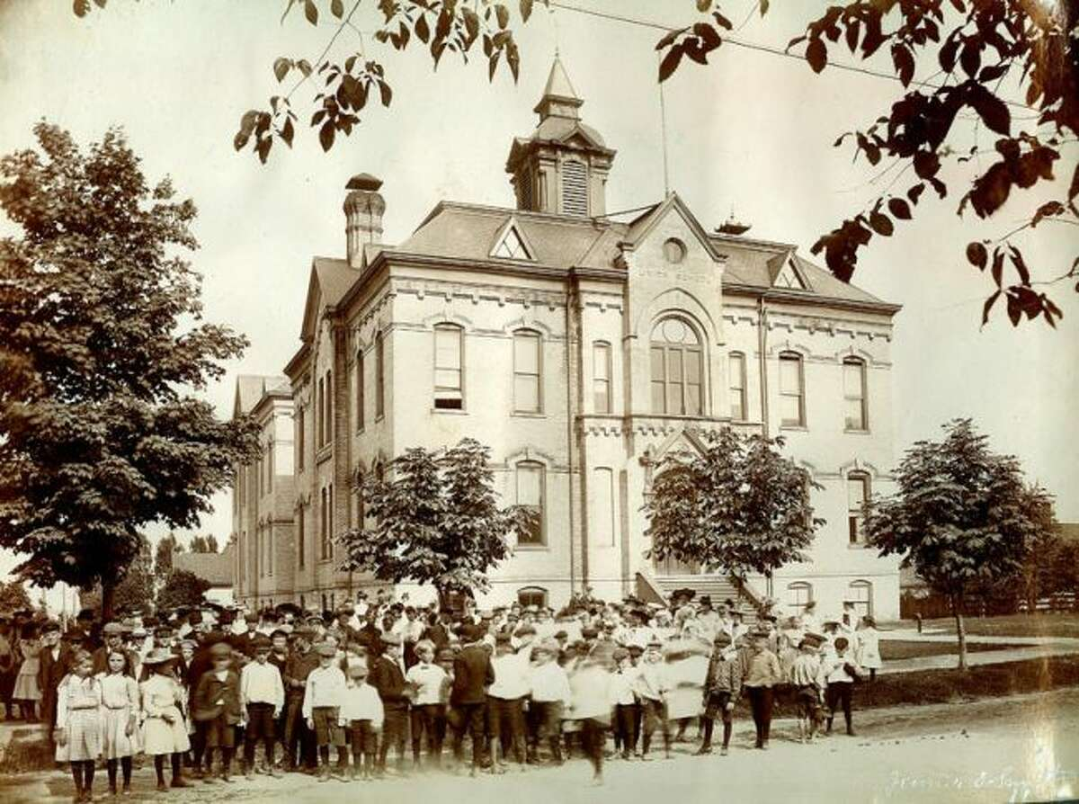 This 1904 photograph shows students standing out in front of the Union School.