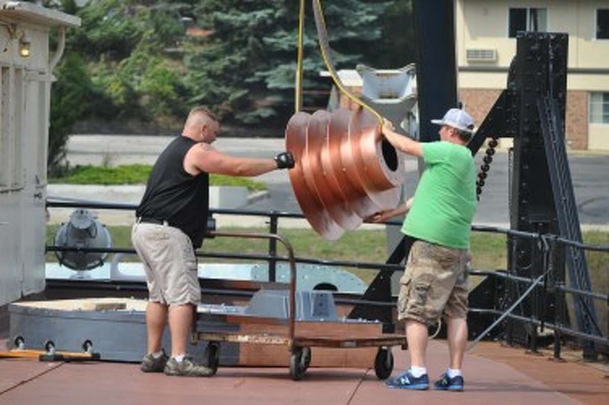 10 West Studios crew members set up props for the new Mickey Matson movie, which will be filmed in September on the S.S. City of Milwaukee in Manistee.