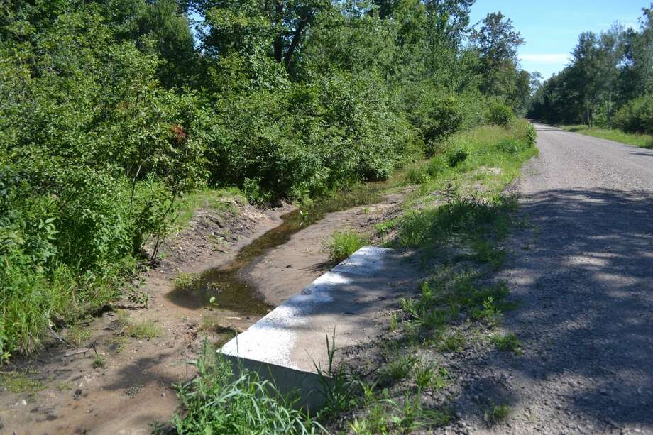Water in the ditch along Kettle Hole Road, seen here on Thursday afternoon, has slowed to a trickle. (Meg LeDuc/News Advocate)