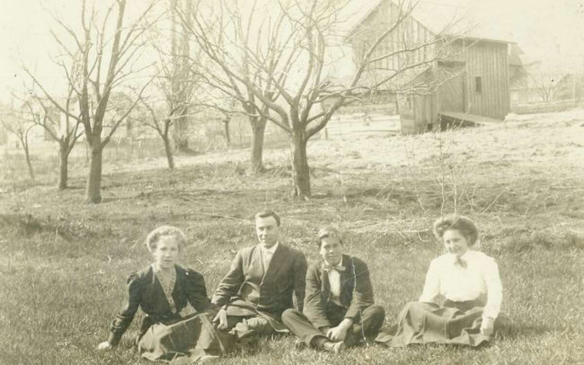 This group of Manistee County residents enjoy a summer day outside in 1890 as indicated in this photograph.