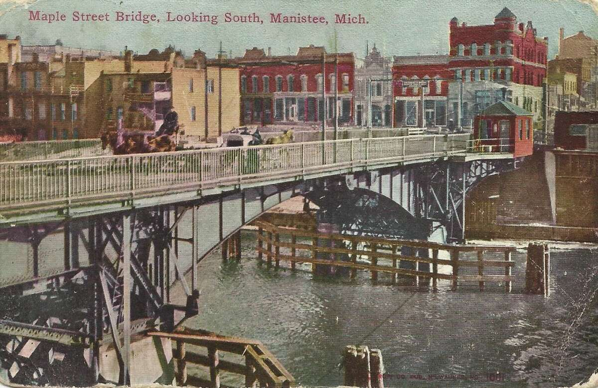 An early 1900's version of the Maple Street Bridge over the Manistee River Channel in Manistee. (Courtesy Photo/Dale Picardat)
