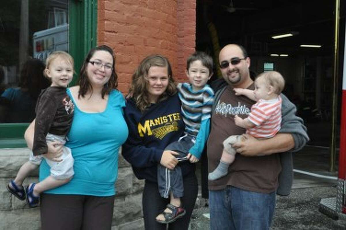 Morgan Haywood (center) was babysitting for Rod Oden and Raquel Jackmond when a fire started Sunday afternoon. She helped save Lucas Oden, 2, Tristan Saunders, 5, and Jamie Oden, who will be one year old in August.