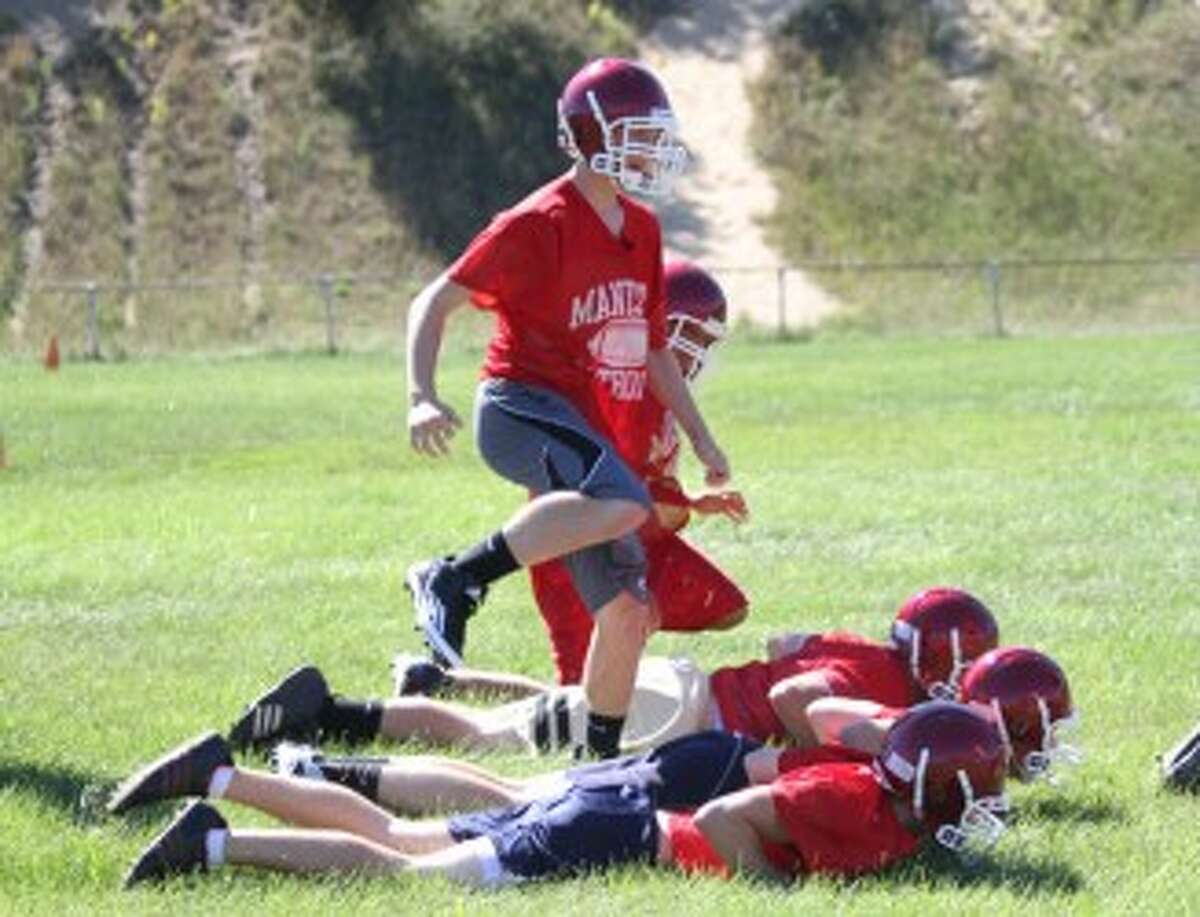 Manistee Catholic Central players loosen up at the start of Monday's practice. (Matt Wenzel/News Advocate)