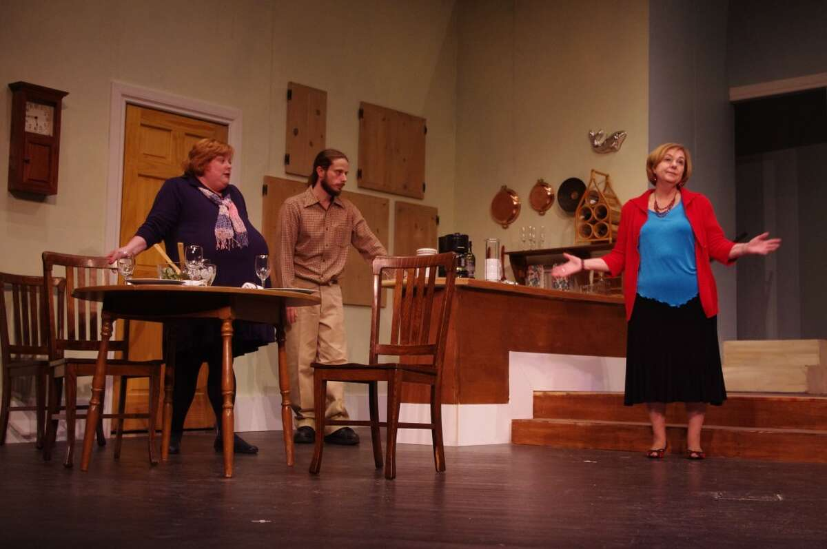 Alice and Jerry Sloan (played by Kathleen Miehlke and Scott Fransee) ask Jerry's mother, Mildred Sloan (played by Jennie Naffie) if she would be willing to move out of their apartment in the Manistee Civic Players production of the comedy