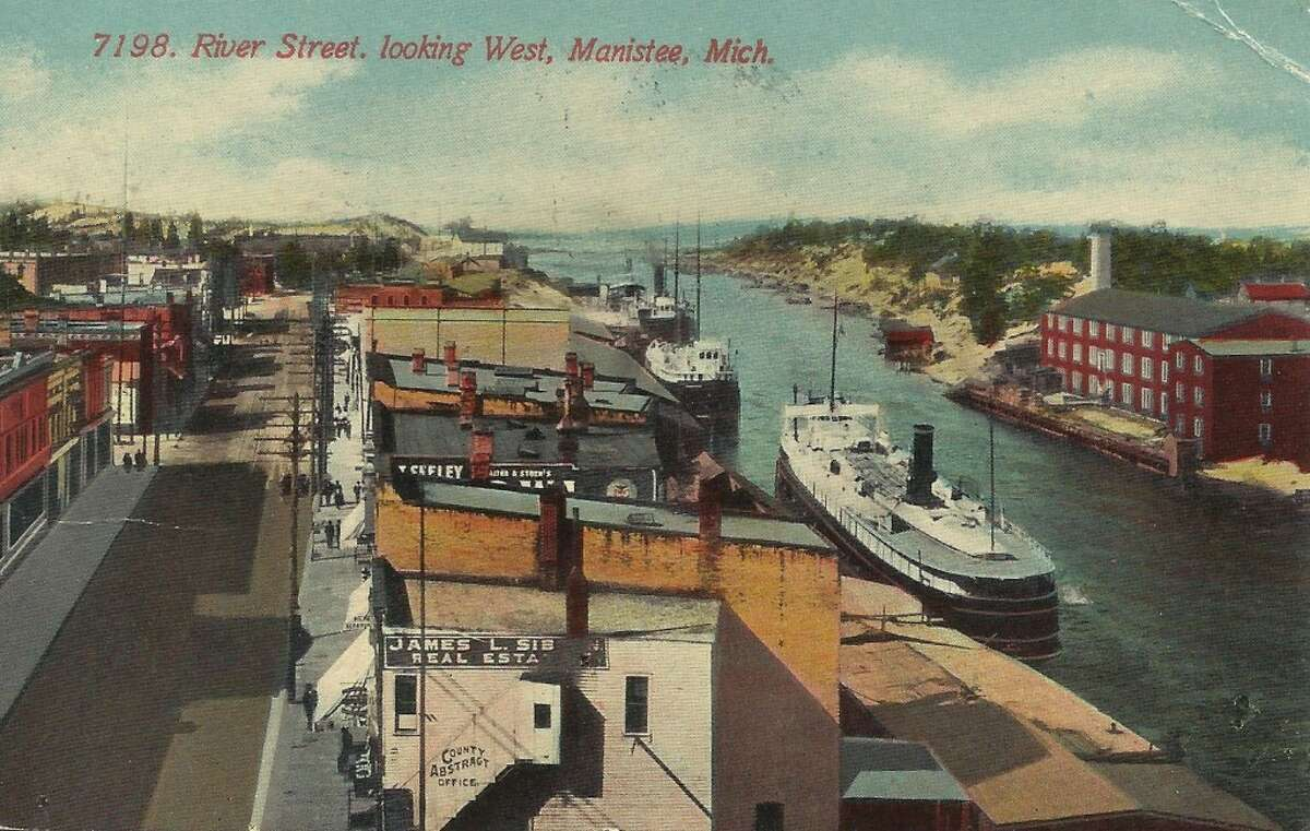 A photo taken in the early 1900's looking westward down River Street and the Manistee River Channel in Manistee. (Courtesy Photo/Dale Picardat)