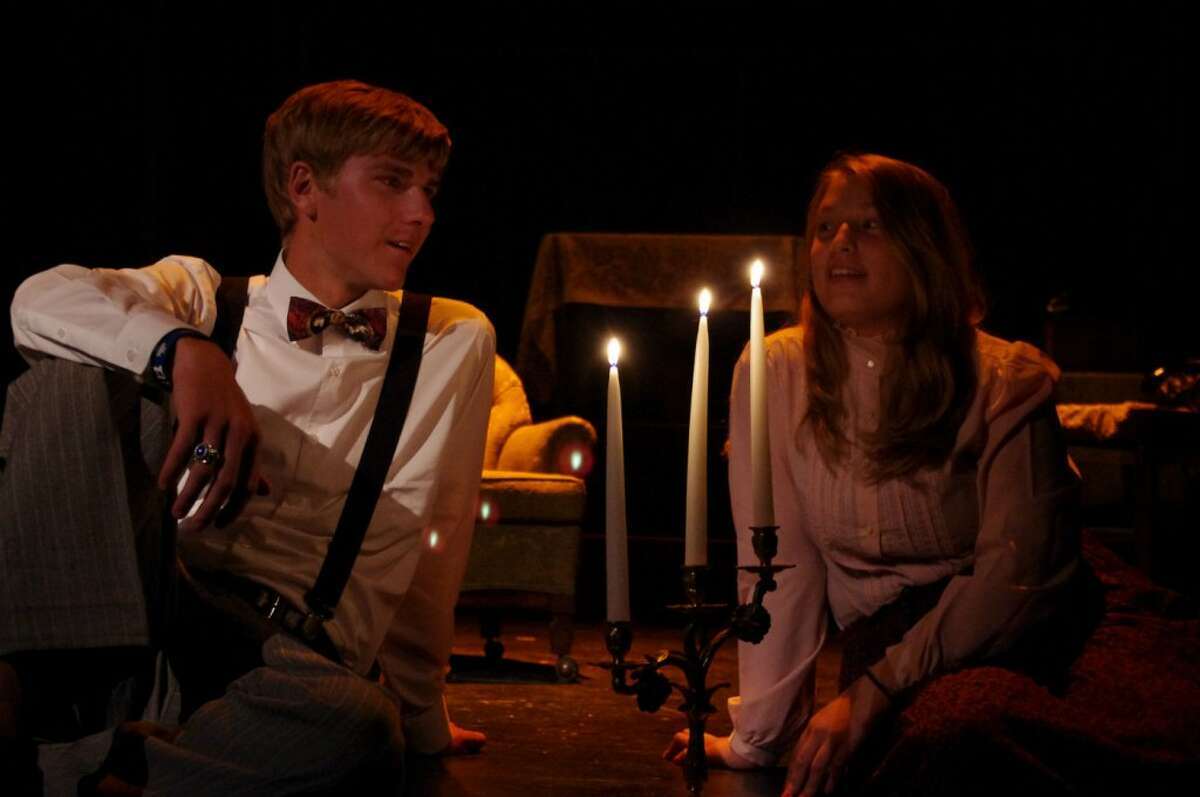 Jim O'Connor, played by Nick Rader, talks with Laura Wingfield, played by Emma Chasse, in the Manistee Civic Players production of