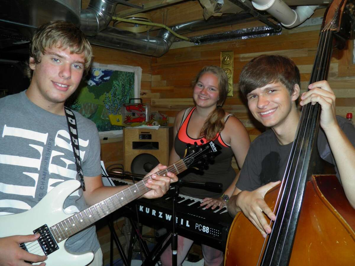 Three of the performers at Friday's 7 p.m. Hunger No Longer benefit concert to be held at Onekama Village Park are, left to right, Gerald Eipperle, Emily Barnard and Tucker Laws. (Courtesy Photo)